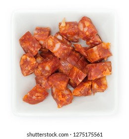 Chorizo pepper sausage chopped in white bowl in top view