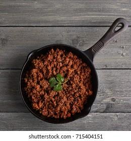 Chorizo in skillet on wood