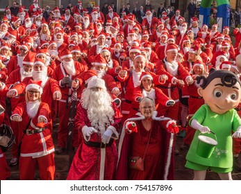 Chorley, Lancashire, UK. November 11th 2017. Over 200 santa's gather outside Chorley Town Hall before starting a 15 mile sponsored walk to Rivington Pike in aid of Derian House, Chorley, Lancashire