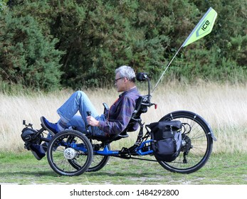 Chorleywood, Hertfordshire, England, UK - August 21st 2019: Male person riding an ICE (Inspired Cycling Engineering) Adventure HD Recumbent Trike