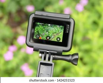 Chorleywood, Hertfordshire, England, UK - June 14th 2019: GoPro Hero 7 White action camera mounted on GoPro 3-Way handle