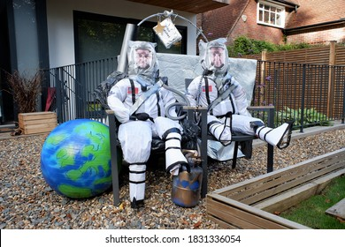 Chorleywood, Hertfordshire, England, UK - October 10th 2020: Scarecrows of NASA astronauts Doug Hurley and Bob Behnken from SpaceX Dragon spacecraft