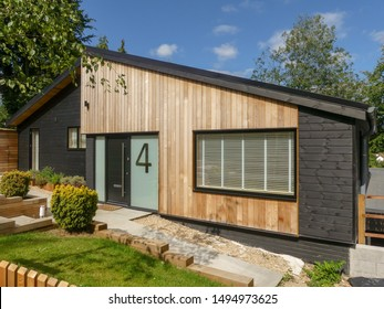 Chorleywood, Hertfordshire, England, UK - September 3rd 2019: A refurbished 1960's bungalow clad with external western red cedar and black timber rainscreen cladding