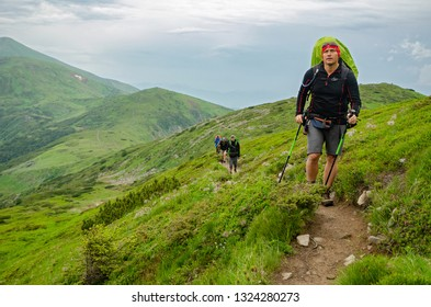 CHORNOHORA MOUNTAINS, UKRAINE   - JUNE 10, 2018 : People hiking in Ukrainian Chornohory  mountains during summer.