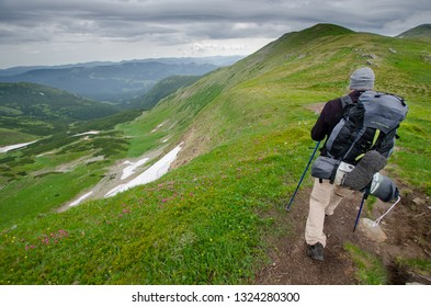 CHORNOHORA MOUNTAINS, UKRAINE   - JUNE 11, 2018 : People hiking in Ukrainian Chornohory  mountains during summer.,