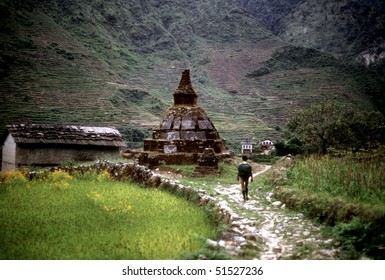 Chortens and porter carrying load