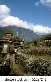 Chortens and porter carrying load,