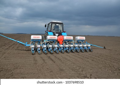 Chortkiv - Ternopil - Ukraine - April 1, 2014. With the use of a precision seed drill, mineral fertilizers are sown and early crops are sown