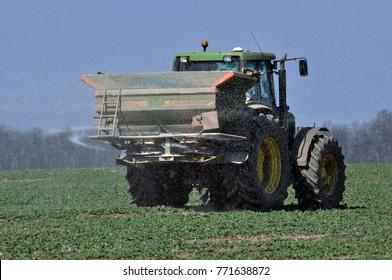 Chortkiv - Ternopil - Ukraine - April 1, 2017. Spring fertilizing fertilizers sowing winter rape in the private agribusiness in the region Chortkiv Ukraine.
