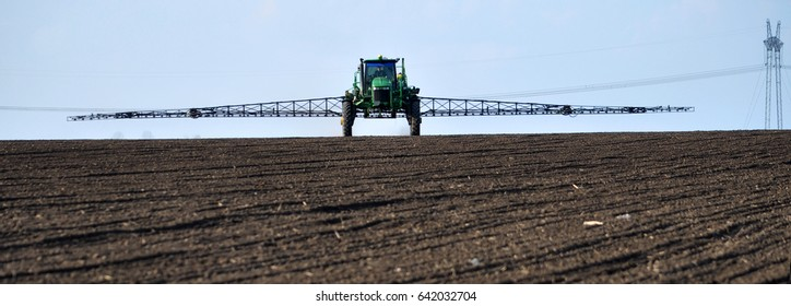 "Chortkiv - Ternopil - Ukraine - April 5, 2017. In the agricultural enterprise ""Bell"" self-propelled sprayer with GPS-navigation herbicides handle spring field"
