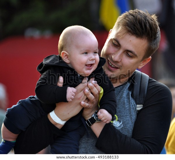 Chortkiv - Ternopil - Ukraine - August 13, 2016. Father and son during the celebration of Chortkiv castle.