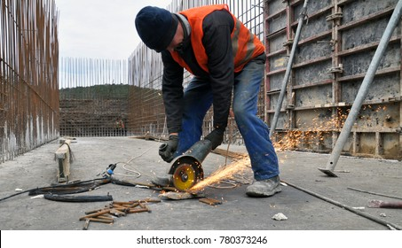 Chortkiv - Ternopil - Ukraine - December 11, 2017. With the use of bulgarian worker cuts the metal armature on construction in the city of Chortkiv