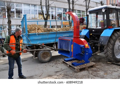 Chortkiv - Ternopil - Ukraine - March 21, 2017. Municipal services after sanitary pruning tree branches in the streets grinds hinged on a special machine