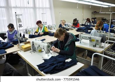 Chortkiv - Ternopil - Ukraine - November 28, 2017. Workers sew clothes at the garment shop in Chortkiv