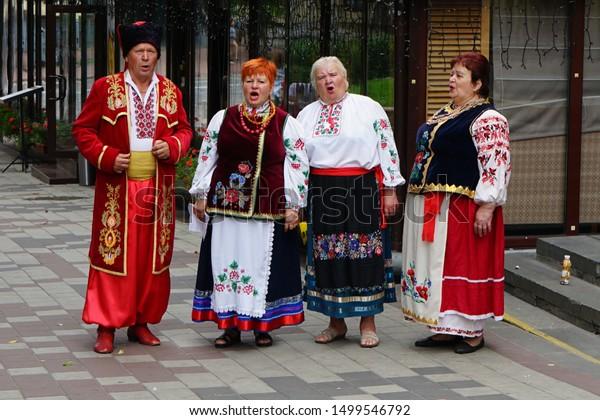 A chorus in national Ukrainian costumes singing a song in the street of Kiev.      08,20,2019 Kiev Ukraine.