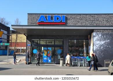 CHORZOW, POLAND - APRIL 7, 2018: People visit Aldi supermarket in Chorzow, Poland. Aldi has 10,000 stores in 20 countries.
