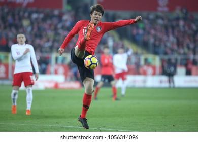 CHORZOW,  POLAND - MARCH 27, 2018: football friendly game: Poland - South Korea o/p Jeong-ho Hong