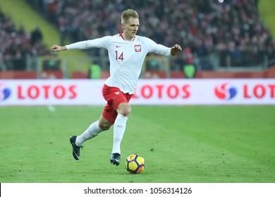 CHORZOW, POLAND - MARCH 27, 2018: football friendly game: Poland - South Korea o/p Lukasz Teodorczyk