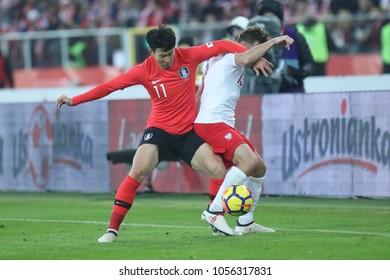 CHORZOW, POLAND - MARCH 27, 2018: football friendly game: Poland - South Korea o/p Maciej Rybus, Heung-min Son