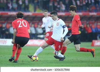 CHORZOW, POLAND - MARCH 27, 2018: football friendly game: Poland - South Korea o/p Robert Lewandowski, Jae-sung Lee