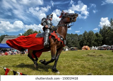 CHORZOW,POLAND, JUNE 9: Medieval knight on horseback during a IV Convention of Christian Knighthood on June 9, 2013, in Chorzow
