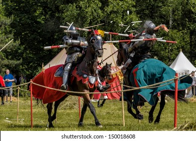 CHORZOW,POLAND, JUNE 9: Medieval knights jousting during a IV Convention of Christian Knighthood on June 9, 2013, in Chorzow
