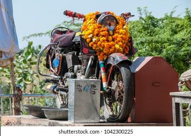 Chotila, Pali-Jodhpur highway, Rajasthan, India - oct 2011  : the Royal Enfield Bullet motorbike adored as a deity in the Om Banna shrine (also called Shri Om Bana and Bullet Banna)