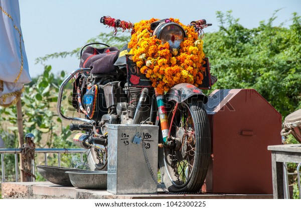Chotila, Pali-Jodhpur highway, Rajasthan, India - oct 2011  : the Royal Enfield Bullet motorbike adored as a deity in the Om Banna shrine (also called Shri Om Bana and Bullet Banna)