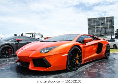 CHOUN BURI - AUGUST 17:  Unidentified racer with Lamborghini car on display at the Thailand Super Series 2013 Race 3 on August 17, 2013 at the Bira International Circuit Pattaya, Thailand.