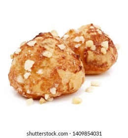Chouquettes (French sugar puffs) isolated on white