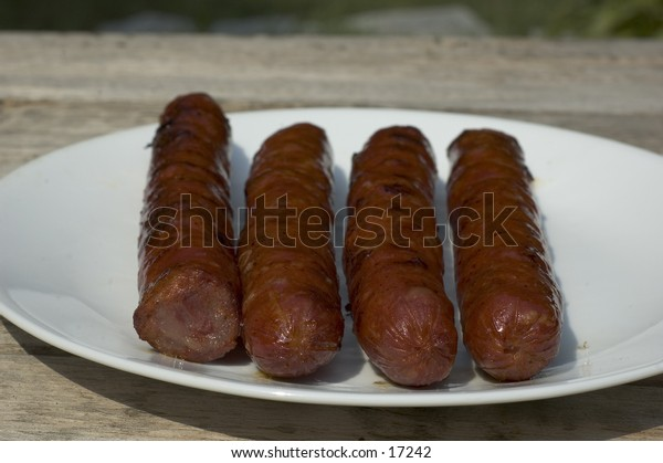 Chouricos (hot sausages) on a plate