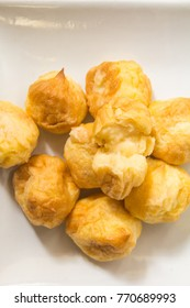 Choux Dough on a plate with white or a coffee break, breakfast charter.