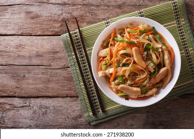 Chow Mein: fried noodles with chicken and vegetables. horizontal view from above