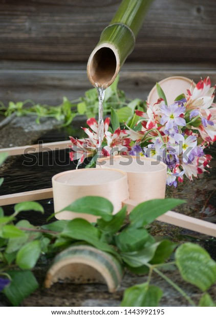 Chozubachi water bowl, a vessel used to rinse the hands in Japanese temples, decorated with beautiful flowers