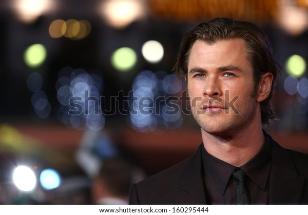 """Chris Hemsworth arriving for the world premiere of """"Thor: The Dark World"""" at the Odeon Leicester Square, London. 22/10/2013"""