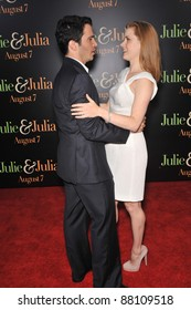 "Chris Messina & Amy Adams at the Los Angeles premiere of their new movie ""Julie & Julia"" at Mann Village Theatre, Westwood. July 27, 2009  Los Angeles, CA Picture: Paul Smith / Featureflash"