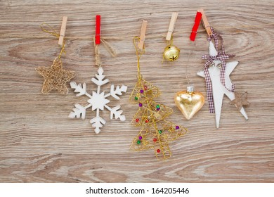 chrismas decorations hanging on rope on wooden background