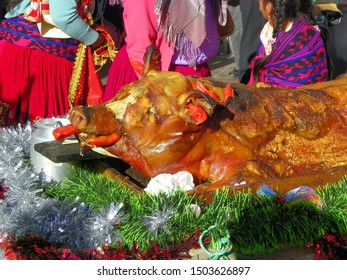 Chrismas Parade Pase del Nino Viajero (Traveling Child) in Cuenca. Close up of roasted pig decorated for parade with tinsel. Whole roasted pig is traditional food in Ecuador