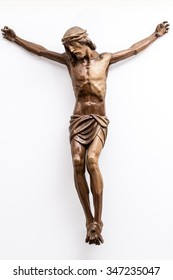 Christ crucified on the white wall of a modern Catholic church