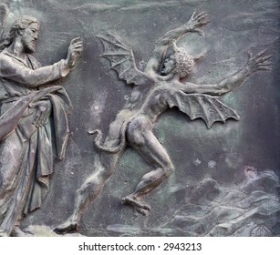 Christ and the devil - ancient bas relief, Pisa, Italy