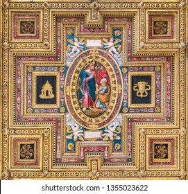 """""""Christ Handing the Keys to Saint Peter"""" wooden panel in the ceiling of the  Church of San Silvestro al Quirinale in Rome, Italy. March-31-2019"""