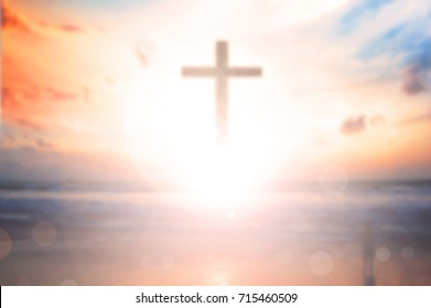 Christ Jesus white cross in the sunrise colored sky background