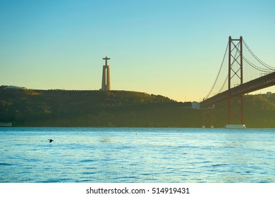 The Christ the King statue and 25 April bridge over the Tagus river. Lisbon, Portugal