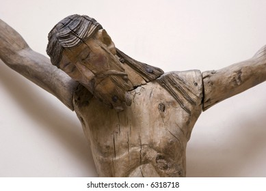 Christ on the cross. Wooden carving from the 12th century (Loire region in France)