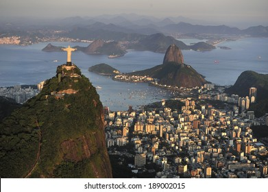 Christ, symbol of Rio de Janeiro, standing on top of Corcovado Hill, overlooking Guanabara Bay and Sugarloaf, Rio de Janeiro, Brazil