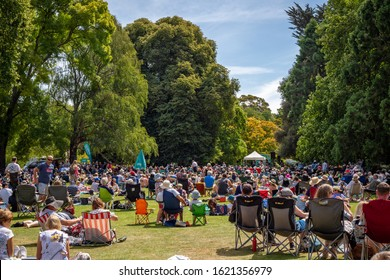 Christchurch, Canterbury, New Zealand, 01/19/2020: People of all ages gather together in a city park for a public summer music event