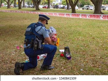 Christchurch, Canterbury, New Zealand, March 17 2019: David McCarthy (NZ Police) takes flowers from the public to place outside the mosque for the victims of the March 15 2019 Christchurch Shootings