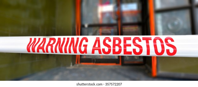 CHRISTCHURCH - DEC 04 2015:Sign reads: Warning - Asbestos removal in progress.Inhalation of asbestos fibers can cause serious and fatal illnesses including lung cancer, mesothelioma and asbestosis.