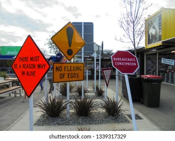Christchurch / New Zealand - 08 06 2017 : funny traffic signs in centre of Re :Start mall, city centre of Christchurch city with shops made from containers as result of damage after earthquake in 2011