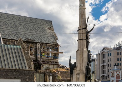 Christchurch, New Zealand - 11 December 2019: Partial view of The Citizens' War Memorial (Soldiers' War Memorial) at Cathedral Square in front of the earthquake damaged Christchurch Cathedral